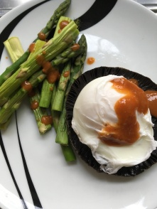 Poached egg on a large flat top mushroom with asparagus